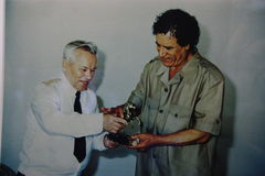 Photo with Kalashnikov and Kaddafi - musiam of wheapon, Izhevsk, Russia 2012 Royalty Free Stock Photo
