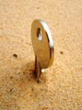 Photo of a key in sand Royalty Free Stock Images