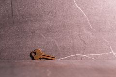 A key and stone background. stock photography