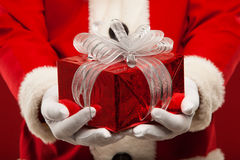 Photo of kind Santa Claus giving xmas present and Royalty Free Stock Images