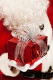 Photo of kind Santa Claus giving xmas present and Stock Photos
