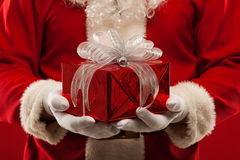 Photo of kind Santa Claus giving xmas present and Royalty Free Stock Photography