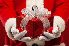 Photo of kind Santa Claus giving xmas present and Royalty Free Stock Image