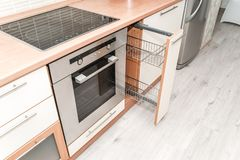 Photo of a kitchen sliding drying cabinet stock photography