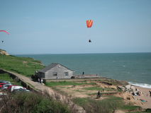 Photo Kite flying Skydiving over west bay Dorset Stock Photography