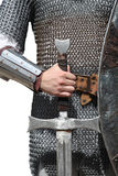 Photo of knight with sword. Isolated Stock Photo