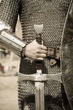 Photo of knight in vintage style. With sword #1 Royalty Free Stock Photography