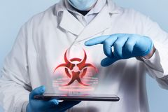 Lab assistant with biohazard sign. royalty free stock photo