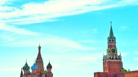 A photo of landmark in moscow St. Basil`s Cathedral and Kremlin Clock Tower on Red Square. stock photos