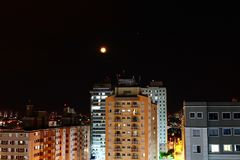 Lunar eclipse behind buildings. stock photography