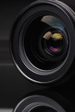 Photo lens. Objective with lens reflections on black background Royalty Free Stock Image