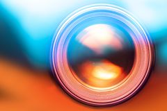 Photo lens on blurred colorful background. Front view stock images