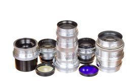 Photo lens and filters. Old lens and filters on white background Stock Image