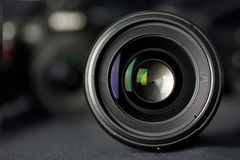 Photo lens front view on blurred camera Stock Photography