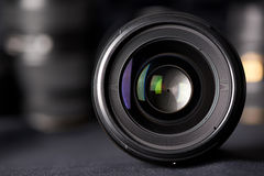 Photo lens front view on blurred texture Stock Photography