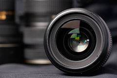 Photo lens front view and optical kit blurred Stock Photography