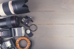 Photo lenses and accessories on wooden background with copy spac Royalty Free Stock Photography