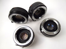 Photo lenses equipment. Group of four isolated lenses for Minolta MD mount - teleconverters. Old photographic equipment for professional photographer Stock Photo