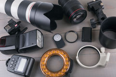 Photo lenses and equipment on wooden table Royalty Free Stock Photos