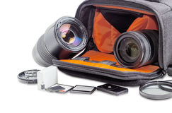 Photo lenses in open camera bag and some photo accessories Royalty Free Stock Photo