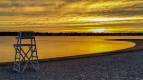 Life guard chair at dusk. Photo of a lifeguard chair with the setting sun in the background stock photos