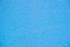 Photo of the light blue colored rough, grunge stucco wall texture. For background royalty free stock photos