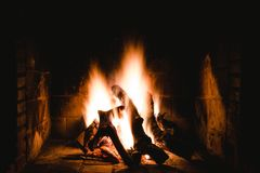 Photo of Lighted Firewoods in Dark Place Royalty Free Stock Photo