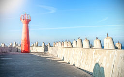 Photo of a lighthouse and concrete block breakwater Royalty Free Stock Photography