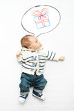 photo of little baby boy dreaming of present Royalty Free Stock Photo