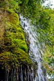 Photo of little waterfall flowing in cave Stock Images