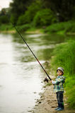 Photo of little boy fishing Stock Image