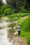 Photo of little boy fishing stock photography
