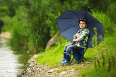 Photo of little boy fishing. On river coast Stock Photos