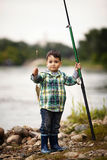 Photo of little boy fishing. On river coast Royalty Free Stock Photos