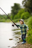 Photo of little boy fishing. On river coast Royalty Free Stock Photography
