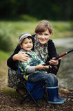 Photo of little boy fishing. Photo of little boy and mother fishing Royalty Free Stock Images