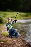 Photo of little boy fishing Stock Photo