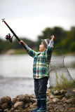 Photo of little boy fishing. On coast of river Royalty Free Stock Photo