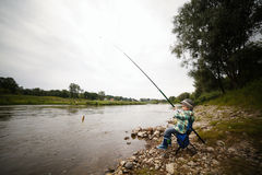 Photo of little boy fishing Royalty Free Stock Image