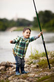 Photo of little boy fishing. On river coast Royalty Free Stock Images