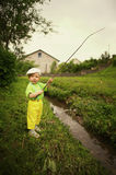 Photo of little boy fishing. Photo of little cute boy fishing Royalty Free Stock Photo