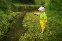 Photo of little boy fishing. Photo of little cute boy fishing Royalty Free Stock Images
