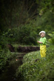 Photo of little boy fishing. Photo of little cute boy fishing on river Stock Photo