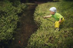 Photo of little boy fishing. Photo of little cute boy fishing on river Stock Photography