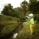 Photo of little boy fishing. Photo of little cute boy fishing on river Royalty Free Stock Photography