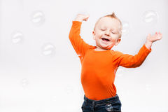 Photo of little boy, playing with soap b stock photography