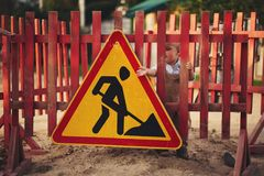 Little boy on the repaired road Royalty Free Stock Photography