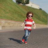 Little funny running boy Royalty Free Stock Image