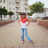 Little girl dancing on the street Royalty Free Stock Photo