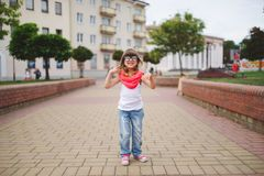 Little girl dancing on the street Stock Photos